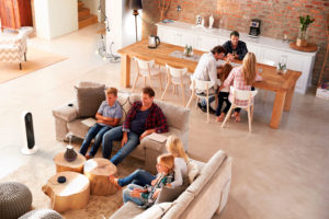 A modern family going about their daily lives, surrounded by atomi smart technology products