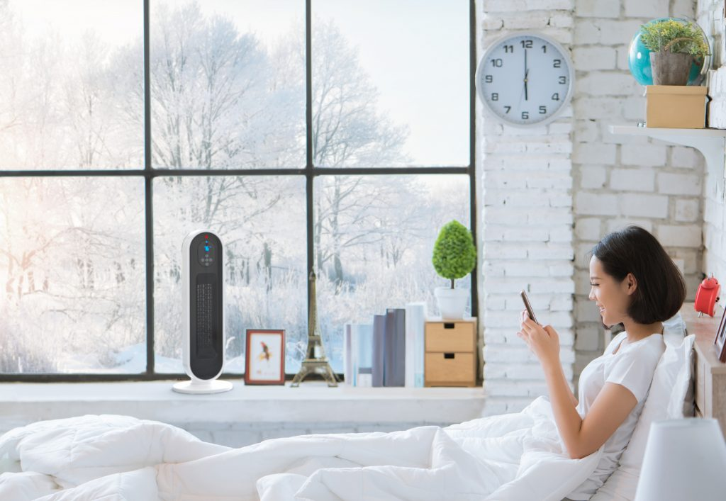 heater-woman-bed